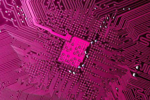 Close up photo of pink pcb printecd circuit board electric paths