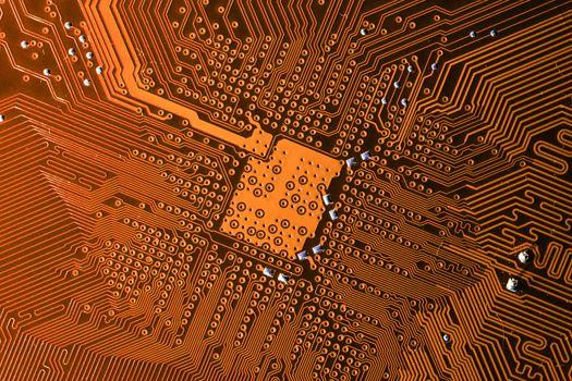 Close up photo of orange pcb printecd circuit board electric paths