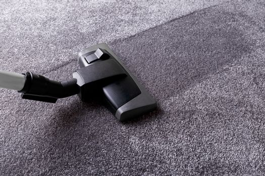 Grey carpet and cleaner