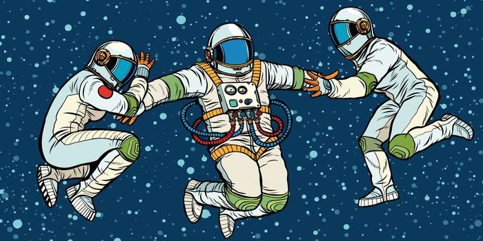 three astronauts in space in zero gravity