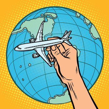 plane in hand. metaphor of flight to the Western hemisphere