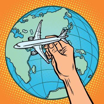 plane in hand. metaphor of flight to the Eastern hemisphere