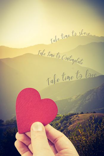 Heart shape with take time to love on landscape