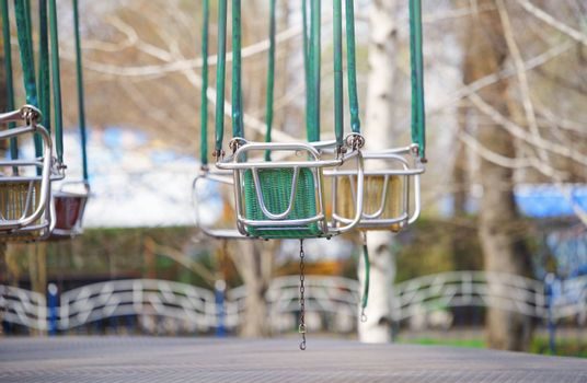 Empty chain swing in amuzement park