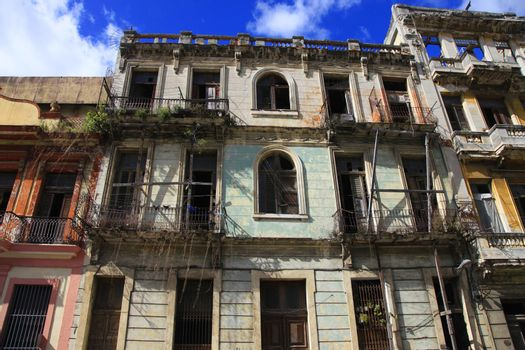 Facade of an old residential building with balconies in Havana, Cuba