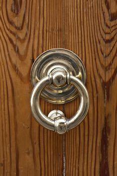 Italian door handle on brown door