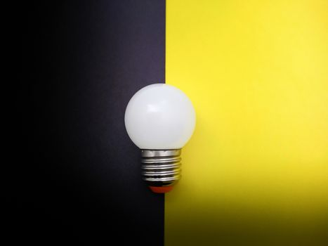 Light Bulb on Black and Yellow Paper