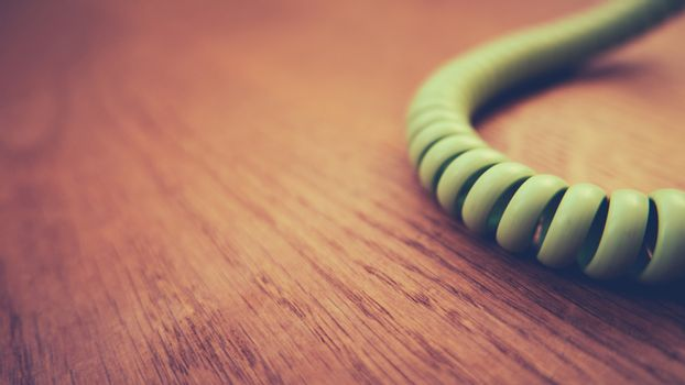 Retro Vintage Phone Cord On Wooden Floorboards With Shallow Focus And Copy Space