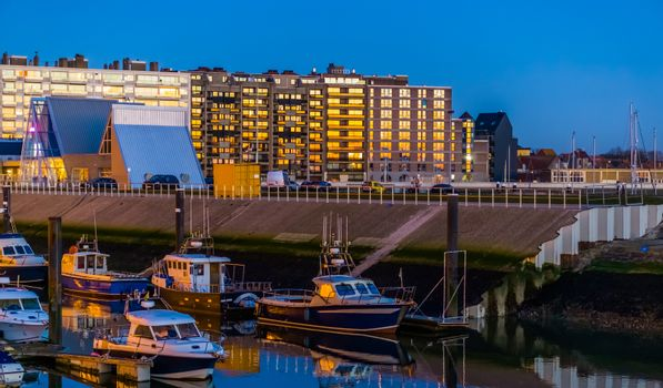 the docks in Blankenberge lighted at night, architecture and city scenery of a popular town in Belgium