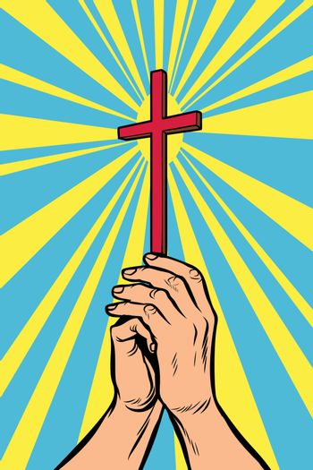 Christian cross in the light, hands of the believer