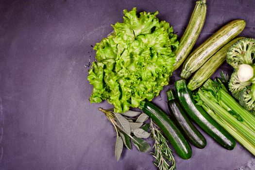 Variety of green organic vegetables. Clean eating food concept.