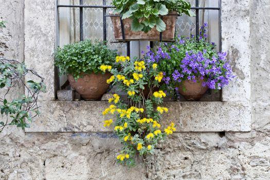 Italian window decorated with flowers.