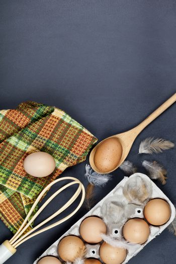 Eggs, kitchen utensil and feathes.