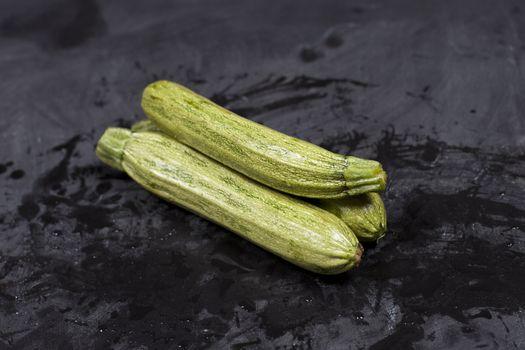 Fresh green wet zucchini.