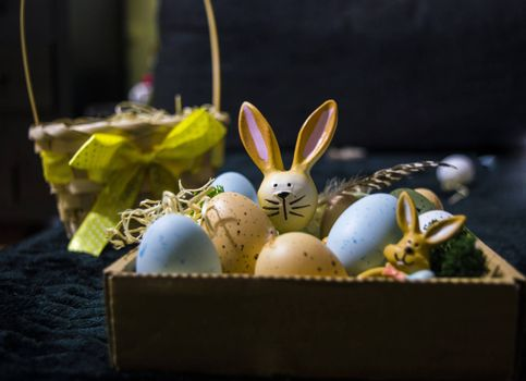 Easter Bunny with Eggs and gift in background