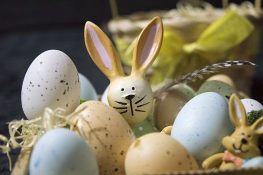 Easter bunny closeup with colorful eggs
