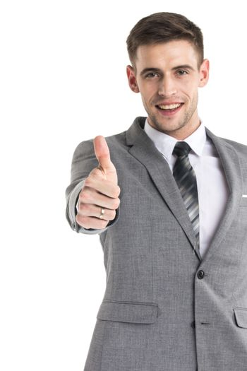 Happy young businessman with thumbs up sign isolated on white background
