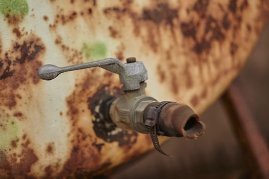 Old rusty faucet corroded by weather