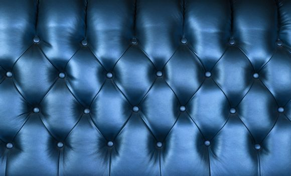 Indigo blue leather capitone background texture