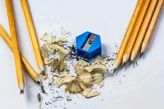 Broken and sharpened pencils with sharpener