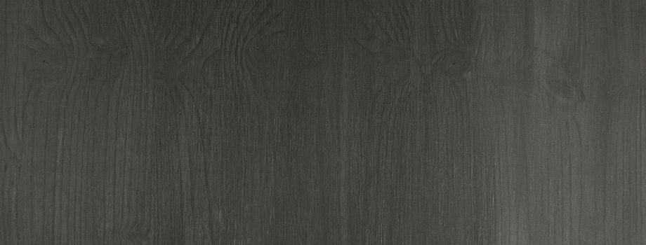 Texture of a black wooden board. May be used as background