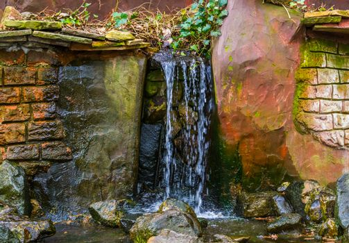 Waterfall with brook in a garden, backyard decorations, streaming water