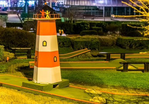 mini golf course with a lighthouse, Recreational sports for adults and kids near the beach