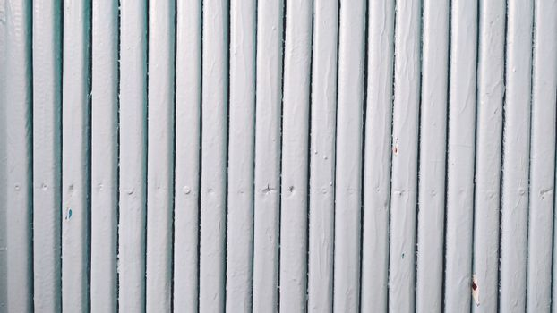 Wooden boards painted blue. Close-up