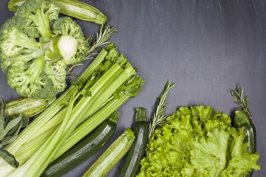 Variety of green vegetables and herbs. Clean eating food concept