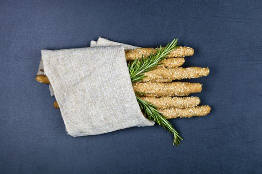 Italian grissini or salted bread sticks with sesame and rosemary