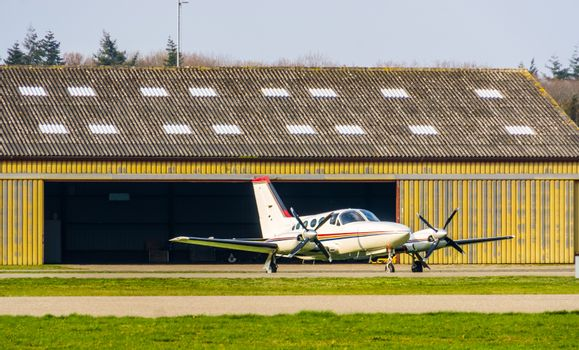 parked white aircraft at the airport, air transportation, recreational sport and hobby