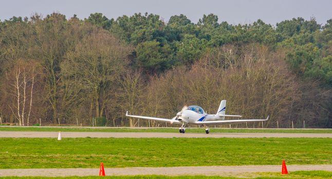 white stunt airplane taking off, recreational air transportation