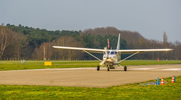 white airplane landing on the air strip, recreational sport and hobby, air transportation