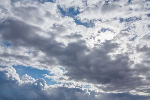 Sun shines through the overcast sky in cloudy weather - image, photo