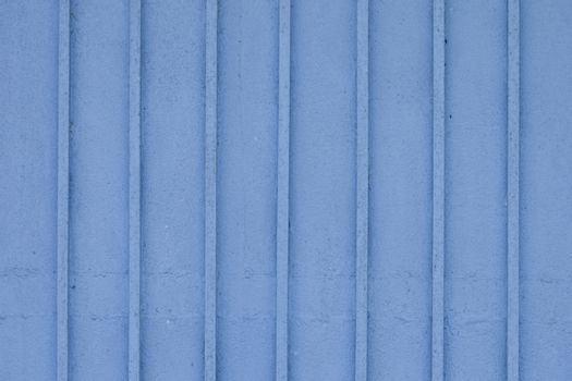 Wooden blue painted striped plank wall.