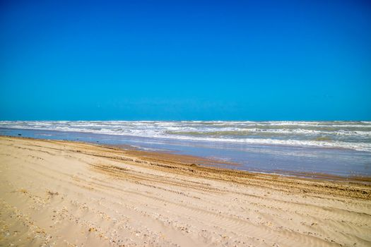 A beautiful soft and fine sandy beach along the gulf coast of Texas in South Padre Island, Texas