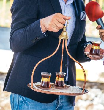 Turkish tea is served in traditional glass