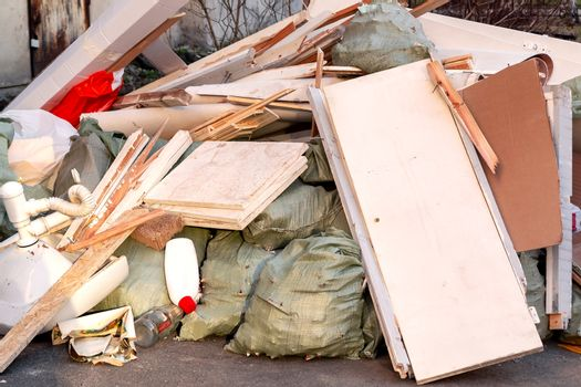 A pile of trash, garbage and old furniture submitted for disposal in the trash