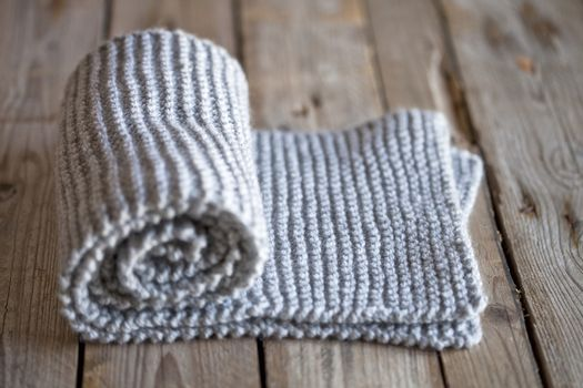 Hand knitted grey scarf.