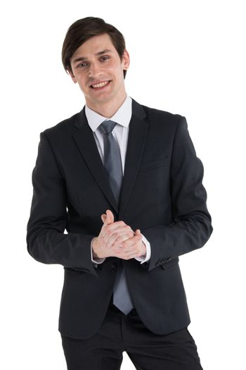 Young smiling business man rubbing his hands , studio isolated on white background