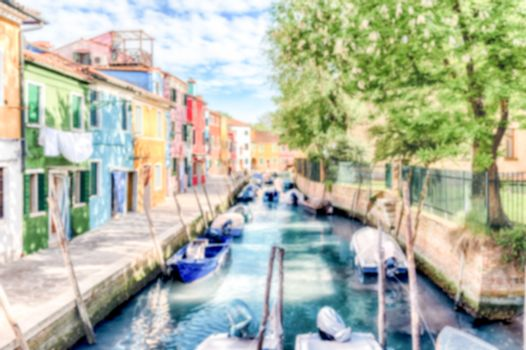 Defocused background of colorful houses along the canal on the island of Burano, Venice, Italy. Intentionally blurred for bokeh effect