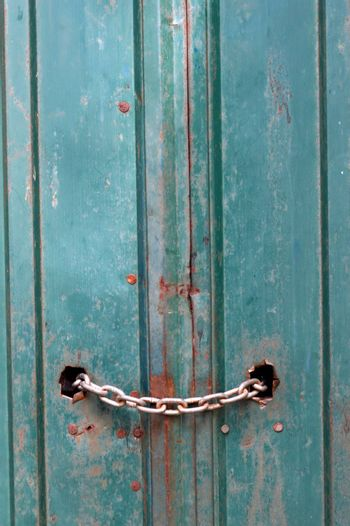 old green iron door