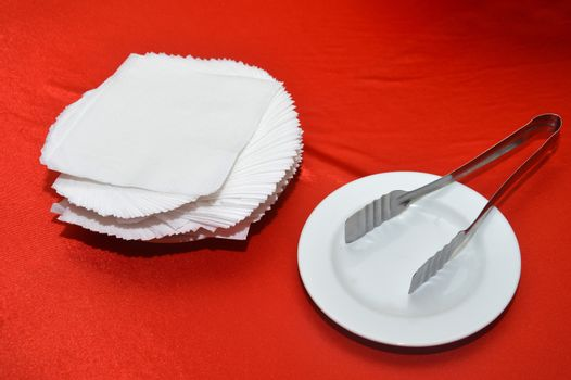white tissues on red table