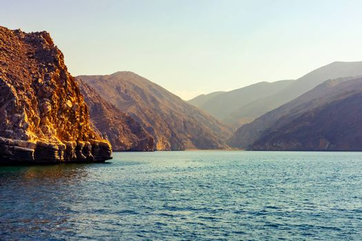 Sea and rocky shores in the fjords of the Gulf of Oman