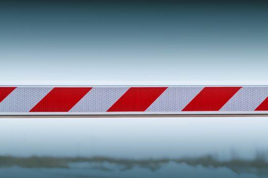 barrier blocking journey against the blue sky