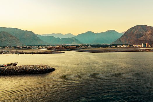 Sea coast of the Gulf of Oman, a small settlement or a town away on the shore