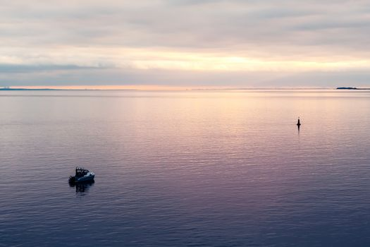 Patrol boat in the Finnish Gulf at sunset