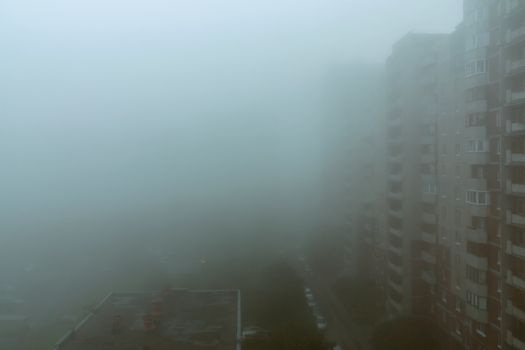 Heavy morning fog and evaporation in the city with high-rise buildings