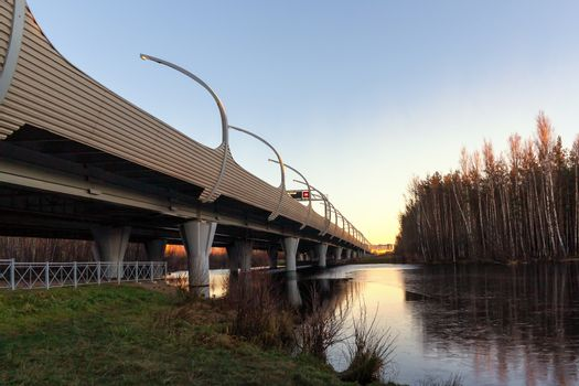 Flyover of the highway over river at sunset