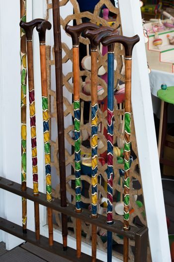 Colorful decorative wooden walking sticks in the view